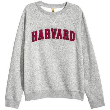 H&M Sweatshirt with Appliqué $24.99