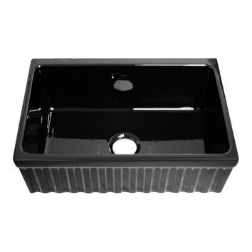 "Quatro Alcove reversible fireclay sink with fluted front apron and decorative 2 ½ inch lip one side and  2"" lip on other"