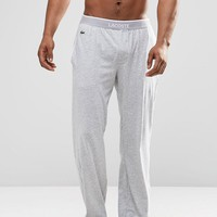 Lacoste Lounge Pants With Logo Waistband In Straight Fit at asos.com