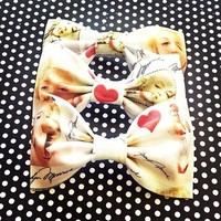 Marilyn Monroe black white vintage print handmade fabric hair bow or bow tie from Bowlicious Divas Bowtique