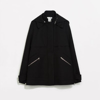 Coat with back pocket