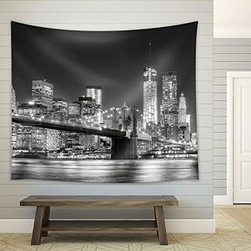 Wall26® - Grayscale Photograph of the Brooklyn Bridge Looking Over New York City at Night Time - Fabric Tapestry, Home Decor - 51x60 inches