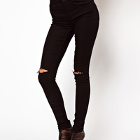 ASOS | ASOS Ridley Supersoft High Waisted Ultra Skinny Jeans in Black with Ripped Knees at ASOS