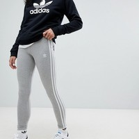 adidas Originals adicolor Three Stripe Leggings In Grey at asos.com