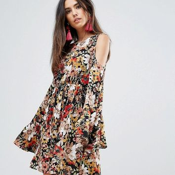 Club L Printed Skater Dress With Flute Sleeves at asos.com