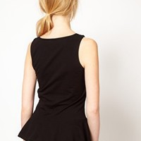 Vero Moda Sleeveless Peplum Top at asos.com