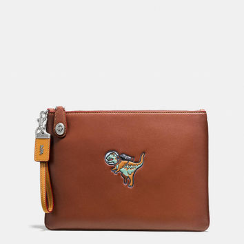 Turnlock Wristlet 30 in Glovetanned Leather With Embossed Space Rexy