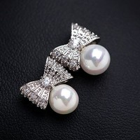 Silver Bow And Pearl Earrings
