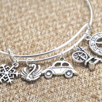 12pcs  Once Upon A Time inspired bracelet  Snowflake Swan  Car  Spinning wheel clock charm bangle bracelet