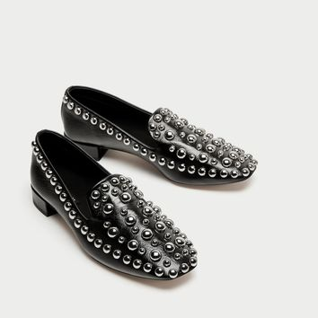 STUDDED LEATHER LOAFERS DETAILS