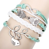 Green and White Handmade Leather Infinity Bracelet with Owl, Dove on Tree, and Infinity Charm