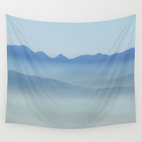"""Misty mountains"". Blue hour Wall Tapestry by Guido Montañés"