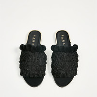SLIDES WITH TASSELS DETAILS