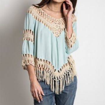 This cute gauze top features a beautiful knit crochet panel with cotton blended construction, knit crochet v-neckline, three quarter sleeves insert with knit crochet and fringed detailing, and long fringe hemline. Unlined. Pair with skinny jeans, denim cut