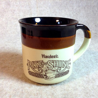 A Vintage Hardee's Mug or Cup - Rise & Shine Homemade Biscuits, advertising ceramic coffee cup.