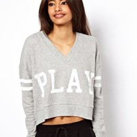 ASOS Sweatshirt with V Neck and Play Print at asos.com