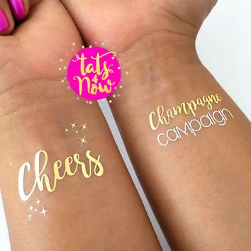 Cheers and Champagne Campaign gold tattoos