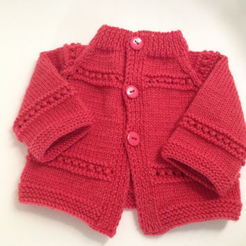 Hand knitted red cardigan , sweater for newborn or 0-3 month old baby girl