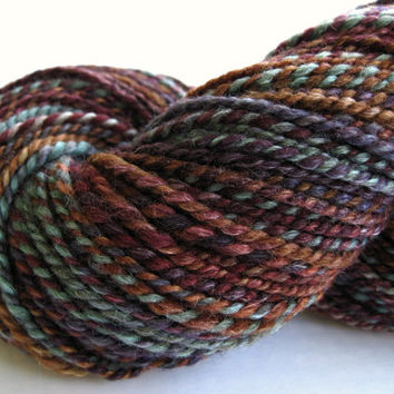 hand spun yarn, handspun yarn, hand dyed yarn, hand painted yarn, BFL Tussah Silk, 2 ply, purple bronze blue yarn, worsted aran bulky weight