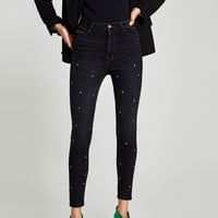 HIGH WAIST JEANS WITH EYELETS