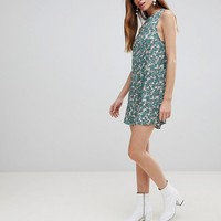 Glamorous Sleeveless Shift Dress With Tie Back In Floral at asos.com