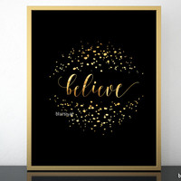 Believe print in black and gold