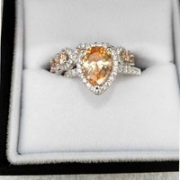Check this out from jeulia! Jeulia Pear Cut Halo Created Champagne Sapphire Wedding Set