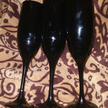 A Stunning Set of Three Libbey Black Amethyst Champagne Flutes