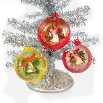 3 Christmas Tree Ornaments - Vintage Plastic Diorama - 2 Red with Angels, 1 Yellow with Bell - 1960s Era Holiday Decor - Optic Interior