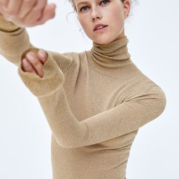 SWEATER WITH METALLIC THREAD DETAILS