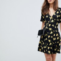 ASOS DESIGN button through tea dress with frill sleeve in marigold print at asos.com