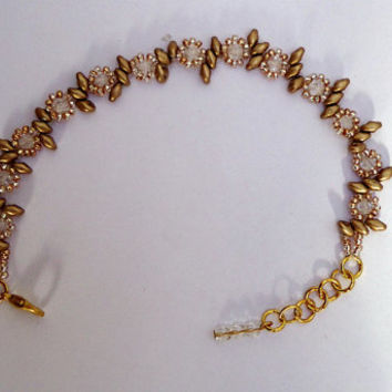 Beaded bracelet in antique gold flower design with super duo beads,crystal fire polished  beads and seed beads. Handmade
