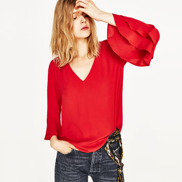FLOWING BLOUSE WITH FRILLS DETAILS
