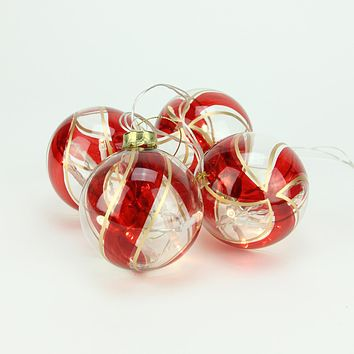 Set of 4 Battery Operated Red and Gold Swirl Glass Ball LED Lighted Christmas Ornaments