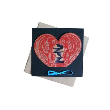 Die cut wood heart card with tattoo keyhole print on natural wooden card, perfect for valentine's day, comes in it's own cardstock holder, packaged in a clear sleeve.