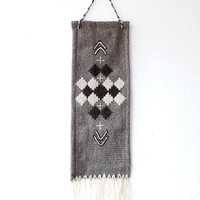 Hand woven wall hanging in brown and white natural wool colorsfor your home decor by Rugs N' Bags
