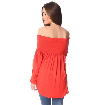 Orange long sleeve top with boat neck