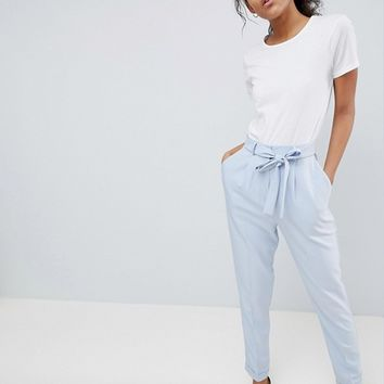 ASOS DESIGN Tall woven peg pants with obi tie at asos.com