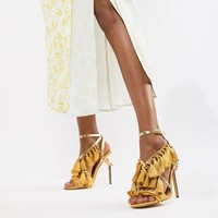 River Island heeled sandals with tassel details in yellow at asos.com