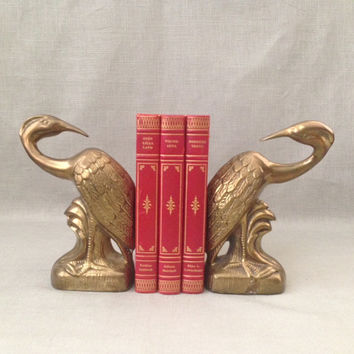 vintage brass bird bookends, perhaps an egret or heron, in a stylized Asian design