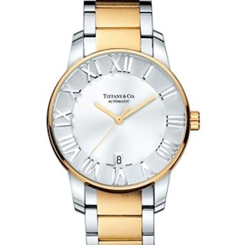Tiffany & Co. -  Atlas® dome watch in stainless steel with 18k gold, mechanical movement.