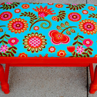 Upcycled bench with floral upholstery
