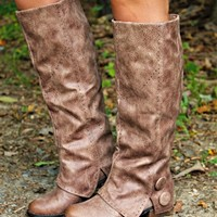 Our Tennessee Waltz Riding Boots in Taupe are ADORABLE! They are a synthetic leather on the exterior with a super soft microfiber interior. They feature detailing throughout with a 'fold over' design near the ankle with two large buttons