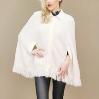 Soft, knit, white vintage cape with collar, buttons and fringe hem | shopcuffs.com