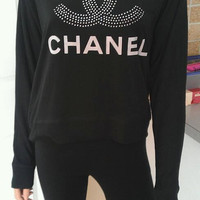 rhinestone Chanel logo on a bella long sleeve over the shoulder flowy