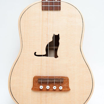 Concert ukulele (customizable sound hole of choice) Example: Cat