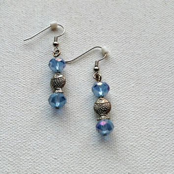 Fish earrings with blue faceted beads.