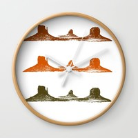 Monument Valley, 3 mountains, 3 colors Wall Clock by Claude Gariepy