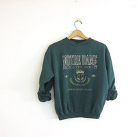 vintage Notre Dame College sweatshirt. cotton blend sweatshirt. green sweatshirt. Fightin Irish sweater