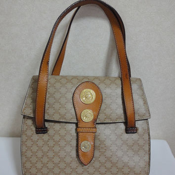 Vintage Celine beige macadam blaison pattern handbag with gold tone coin motif charms. Very rare piece from CELINE.